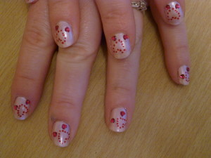Valentines hearts on pink nail art 300x225 Valentines hearts on pink nail art