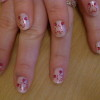 Valentines hearts on pink nail art